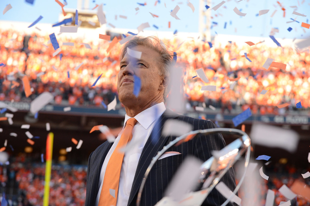 . John Elway with the Conference Championship trophy at the end of the game. The Denver Broncos take on the New England Patriots in the AFC Championship game at Sports Authority Field at Mile High in Denver on January 19, 2014. (Photo by John Leyba/The Denver Post)