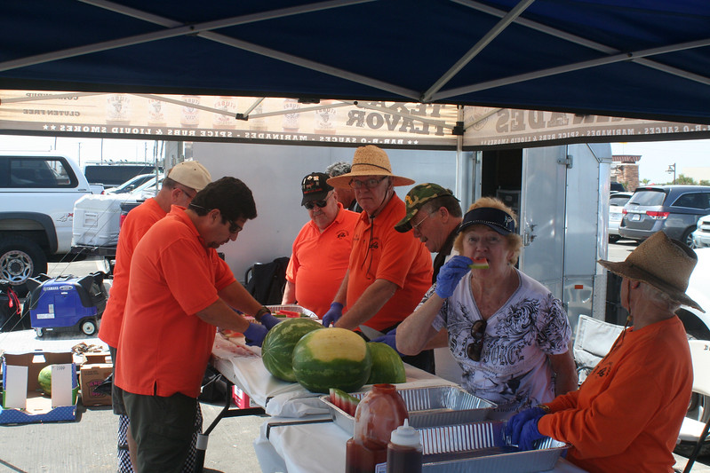 cutting and sampling the watermellon.jpg