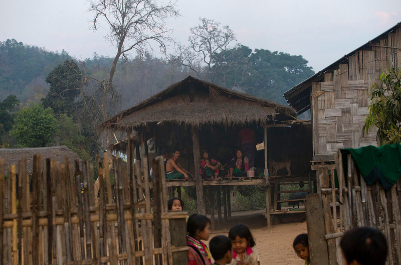 . Ethnic Lisu villagers, some dressed in traditional clothing, gather in a traditional Lisu house in Thon Min Yar village, central Shan state, Myanmar. Far from Myanmar\'s postcard-perfect pagodas and colonial relics, the remote mountain villages of southern Shan State do not appear on maps of Myanmar or in any guide books. In obscurity, they have been ground zero for Myanmar\'s drug trade which has thrived on poverty and corruption. (AP Photo/Gemunu Amarasinghe)
