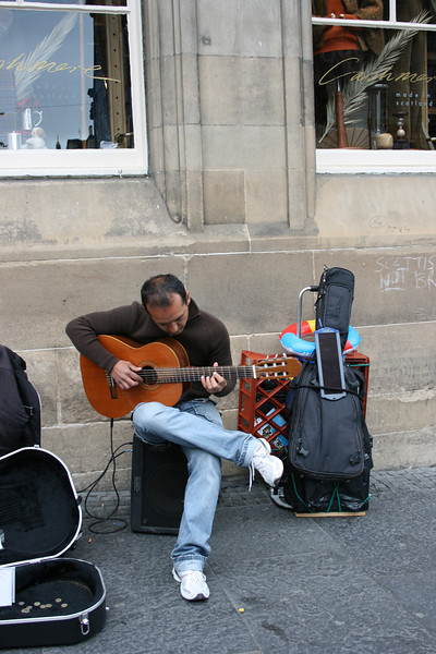 This man was playing some amazing guitar work.  Note the solar cell on his guitar case.
