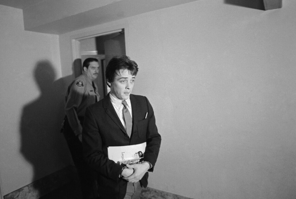 ". Robert K.Beausoleil, 21, leaves a Los Angeles courtroom Jan. 21, 1970 in Los Angeles, after asking a change of venue for his trial on a charge of murdering Malibu Musician Gary Hinman last July 25. Also charged is Susan Denise Atkins, alleged member of the Charles Manson ""family\"". The court will rule Friday on the petition. (AP Photo/George Brich )"