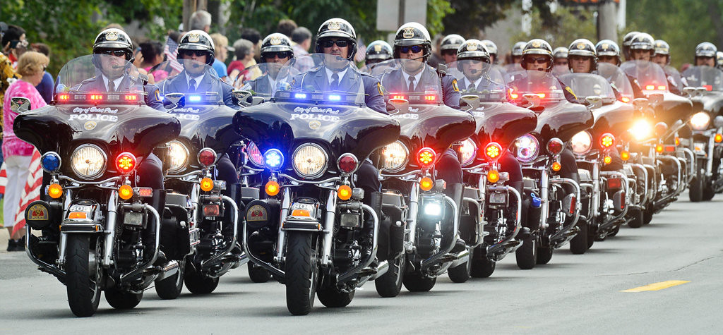 . A group of St. Paul police officers on motorcycles lead the funeral procession for officer Scott Patrick from St. Stephen�s  Wednesday.  (Pioneer Press: Ben Garvin)