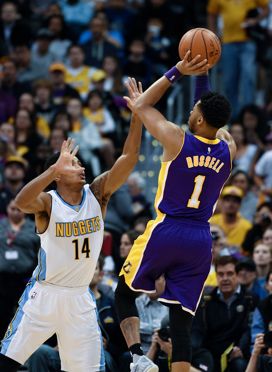 . DENVER, CO - MARCH 02: Los Angeles Lakers guard D\'Angelo Russell (1) takes a shot over Denver Nuggets guard Gary Harris (14) during the first quarter March 2, 2016 at Pepsi Center. (Photo By John Leyba/The Denver Post)