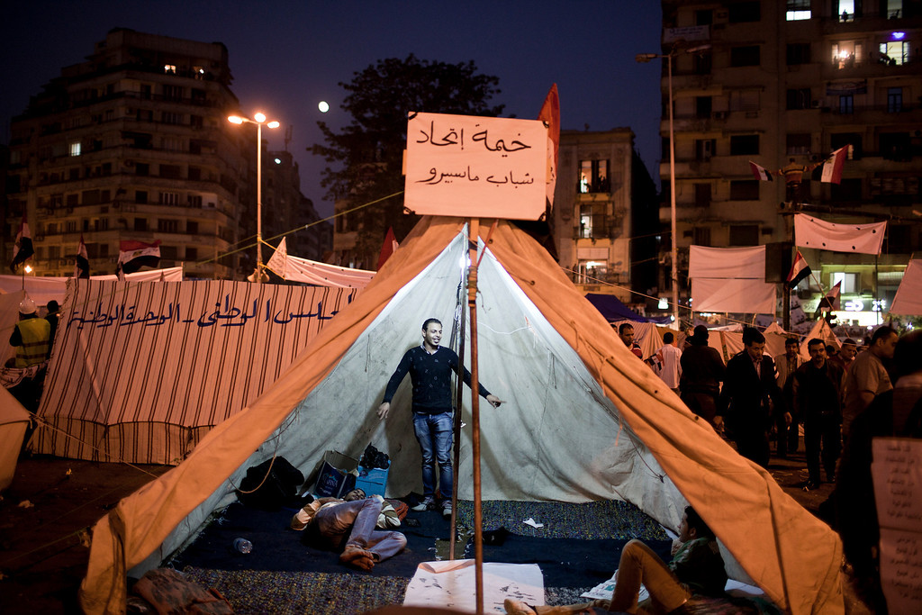 . Protesters in a tent in Cairo\'s Tahrir Square, Nov. 27, 2012. Demonstrators began flowing into the streets of Cairo Tuesday for a day of protest against President Mohammed Morsi\'s effort to assert broad new powers, dismissing his efforts only hours before to reaffirm his deference to Egyptian law and courts. (Ivor Prickett/The New York Times)
