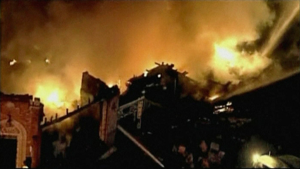 . A still image taken from a KHSB-TV video footage shows aerial of the flames and firefighters working at the scene of a fire at Kansas City, Missouri February 19, 2013. A fire triggered by a natural gas explosion that appeared to have originated underground engulfed a restaurant in Kansas City, Missouri, on Tuesday, injuring more than a dozen people, authorities and witnesses said.  REUTERS/KHSB-TV