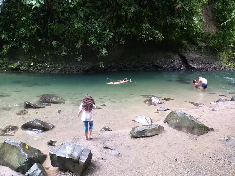 Children Play below the plunge pool