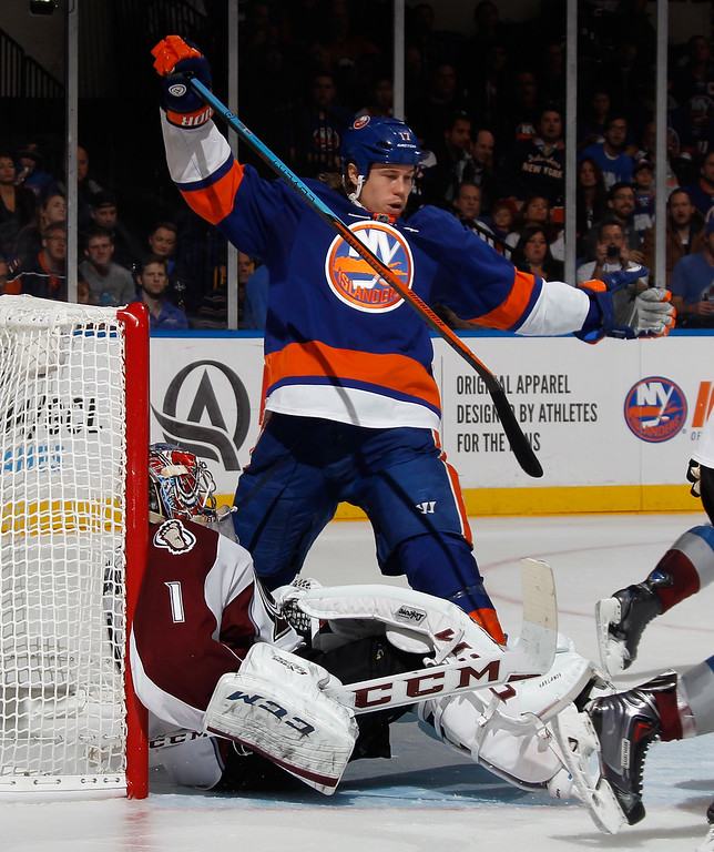 . UNIONDALE, NY - NOVEMBER 11: Matt Martin #17 of the New York Islanders bounces off Semyon Varlamov #1 of the Colorado Avalanche during the second period at the Nassau Veterans Memorial Coliseum on November 11, 2014 in Uniondale, New York.  (Photo by Bruce Bennett/Getty Images)