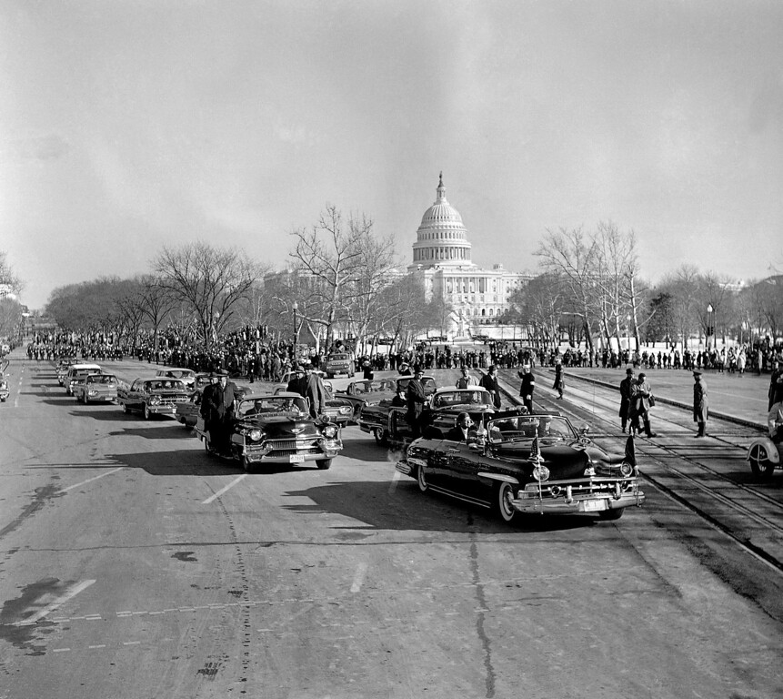 . President John F. Kennedy rides in a black automobile in the traditional inaugural parade in Washington, Jan. 20, 1961. The Capitol is in background. His car is at the intersection of Constitution Ave. left, and Pennsylvania Avenue. (AP Photo)
