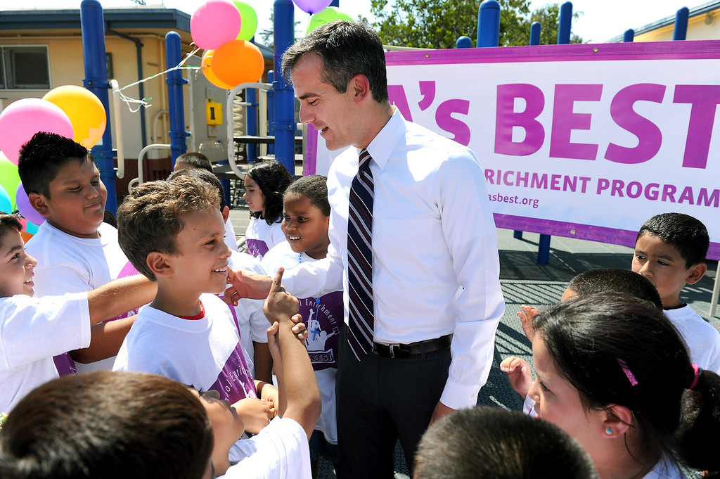. Mayor Eric Garcetti talks with children at Oxnard Street Elementary School in North Hollywood, Tuesday, August 13, 2013, after announcing the opening of five new LA\'s BEST After School Enrichment Programs. One of the sites will be at Michelle Obama Elementary School in Panorama City. (Michael Owen Baker/L.A. Daily News)
