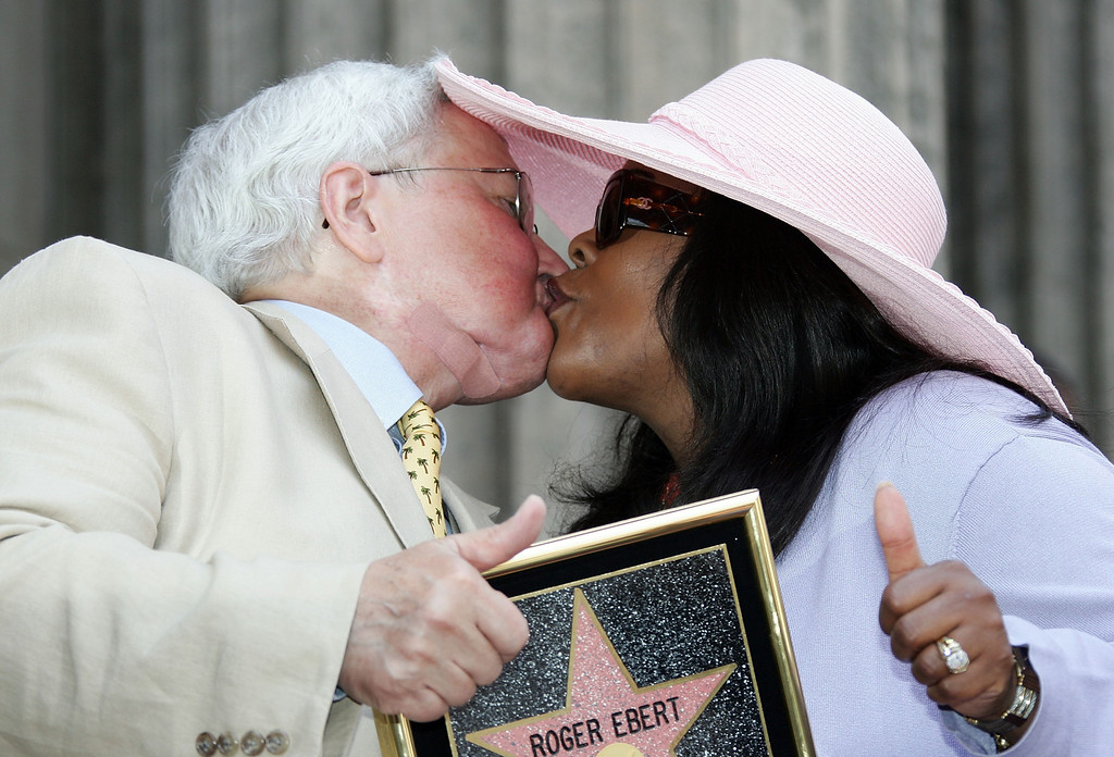 . Movie Critic Roger Ebert and his wife, Chaz Ebert, kiss as he receives the 2,288th Star on the Hollywood Walk of Fame June 23, 2005 in Hollywood, California.  (Photo by Frazer Harrison/Getty Images)