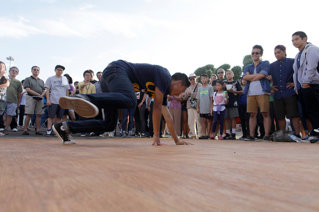 . Jason Reo, 19, entertains the crowd on the dance floor during the 626 night market at Santa Anita Park in Arcadia, Saturday August 3, 2013. (SGVN/Correspondent Photo by Ron Fu/SVCITY)