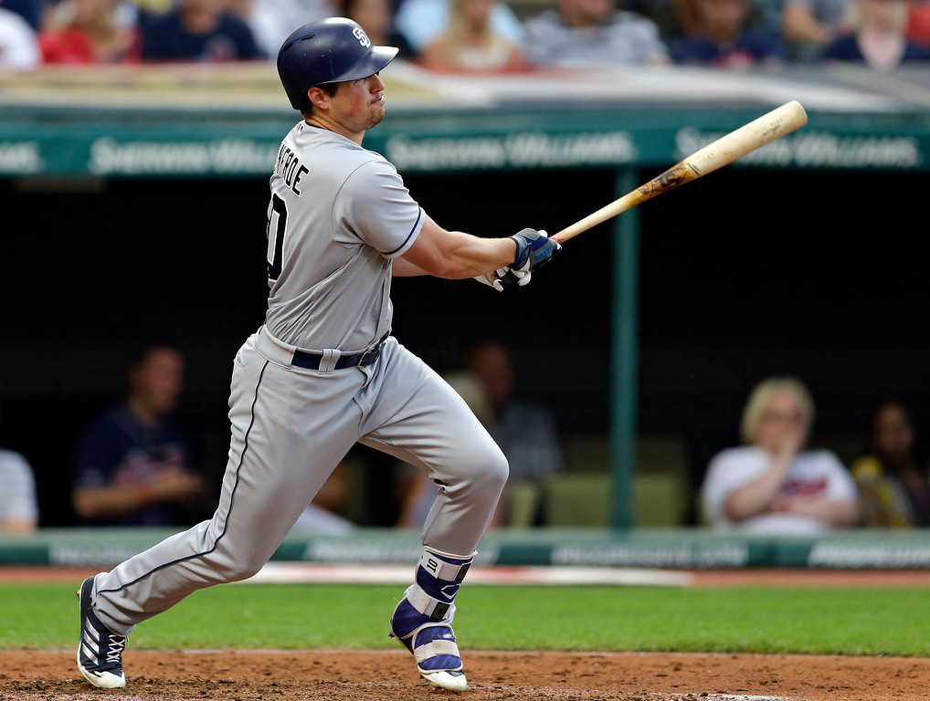 . San Diego Padres\' Hunter Renfroe hits against Cleveland Indians starting pitcher Trevor Bauer in the fifth inning of a baseball game, Wednesday, July 5, 2017, in Cleveland. Renfroe was safe at first base on an error by Francisco Lindor. Jose Pirela scored on the play. (AP Photo/Tony Dejak)