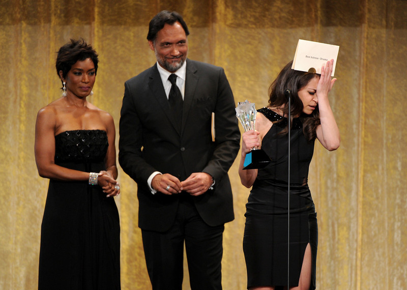 """. Tatiana Maslany, right, accepts award for best actress in a drama series for \""""Orphan Black\"""" at the Critics\' Choice Television Awards in the Beverly Hilton Hotel on Monday, June 10, 2013, in Beverly Hills, Calif. Looking on from left presenters Angela Bassett and Jimmy Smits. (Photo by Frank Micelotta/Invision/AP)"""