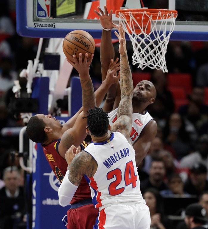 . Cleveland Cavaliers forward Channing Frye (8) attempts shooting over the defense of Detroit Pistons forward Eric Moreland (24) and forward Anthony Tolliver during the first half of an NBA basketball game, Monday, Nov. 20, 2017, in Detroit. (AP Photo/Carlos Osorio)