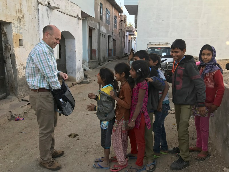 The kids heard that the white man walking through the village was giving out pieces of toffee candy...caused so much fervor that he had to make them form a line to keep order!  They got a kick out of that!