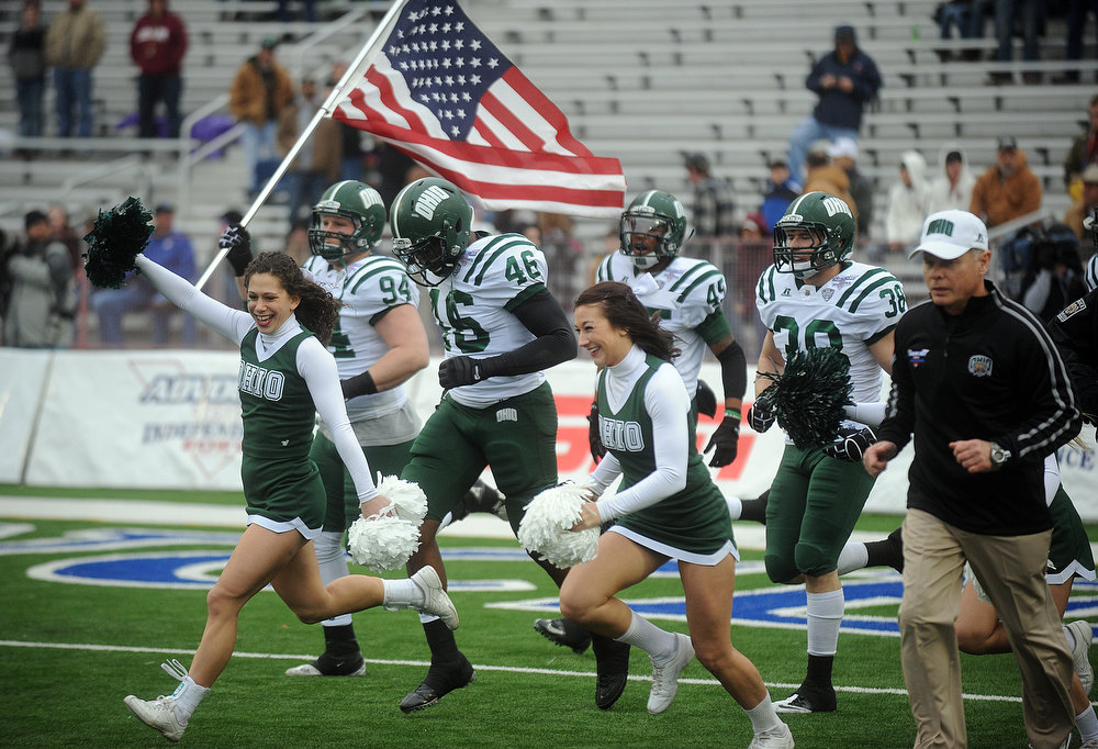 . Ohio\'s Corey Hasting carries the American Flag as Ohio takes the field for the the Independence Bowl NCAA college football game against Louisiana-Monroe, Friday, Dec. 28, 2012, in Shreveport, La. (AP Photo/The Shreveport Times, Douglas Collier)