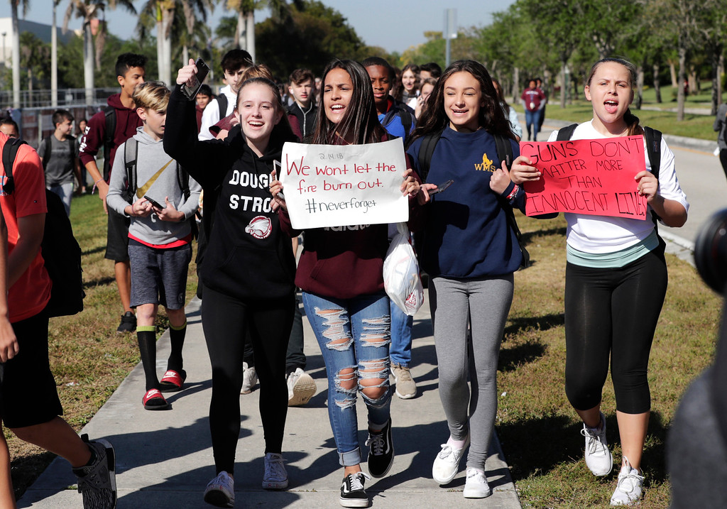 . Students from Westglades Middle School walk out of their school as part of a nationwide protest against gun violence, Wednesday, March 14, 2018, in Parkland, Fla. Students across the country participate in walkouts Wednesday to protest gun violence, one month after the deadly shooting inside Marjory Stoneman Douglas High School in Parkland, Fla. (AP Photo/Lynne Sladky)