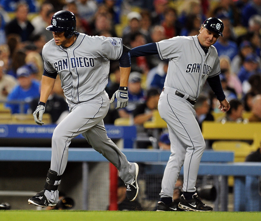 . San Diego Padres\' Kyle Blanks rounds third base past San Diego Padres third base coach Glenn Hoffman after hitting a solo home run in the sixth inning of their baseball game against the Los Angeles Dodgers on Wednesday, April 17, 2013 in Los Angeles.   (Keith Birmingham/Pasadena Star-News)