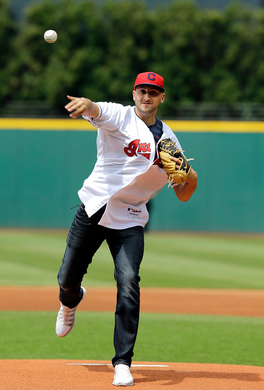 . Cleveland Browns quarterback Brian Hoyer throws a ceremonial pitch before a baseball game between the Chicago White Sox and the Cleveland Indians Saturday, July 12, 2014, in Cleveland. (AP Photo/Mark Duncan)