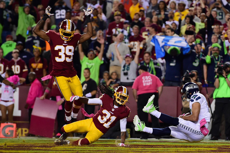 . Wide receiver Jermaine Kearse #15 of the Seattle Seahawks catches a first quarter touchdown pass while defended by strong safety Brandon Meriweather #31 of the Washington Redskins and cornerback David Amerson #39 at FedExField on October 6, 2014 in Landover, Maryland.  (Photo by Patrick Smith/Getty Images)