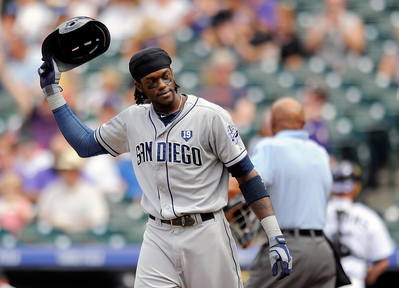 . San Diego Padres\' Cameron Maybin tosses his helmet after striking out in the second inning of a baseball game against the Colorado Rockies Sunday, Sept. 7, 2014, in Denver. (AP Photo/Chris Schneider)