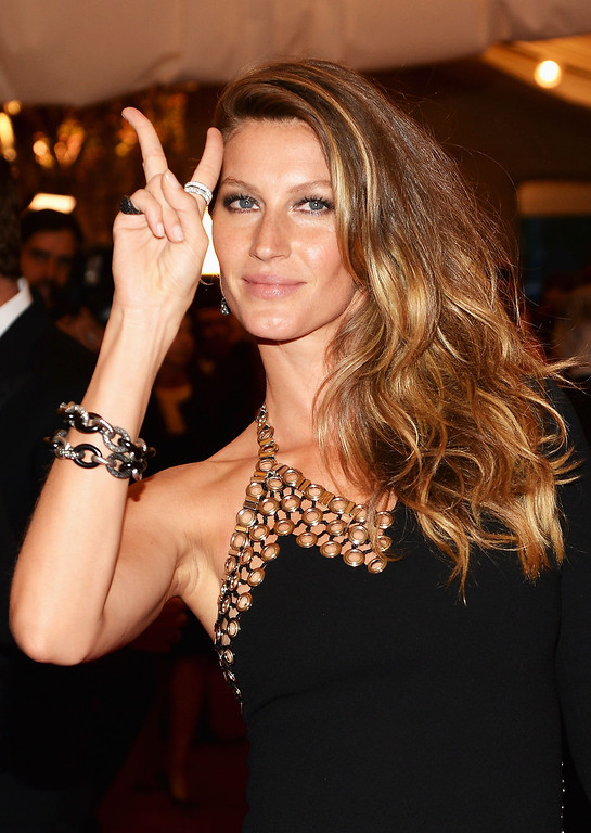 """. Gisele Bundchen attends the Costume Institute Gala for the \""""PUNK: Chaos to Couture\"""" exhibition at the Metropolitan Museum of Art on May 6, 2013 in New York City.  (Photo by Dimitrios Kambouris/Getty Images)"""