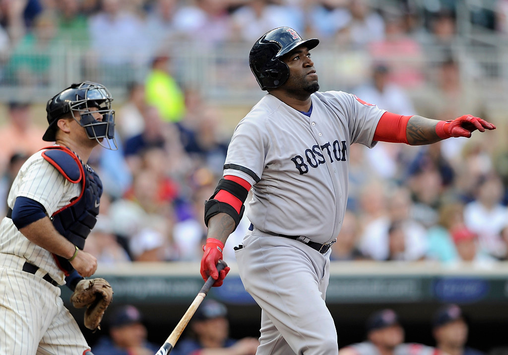 . Twins catcher Ryan Doumit and Boston\'s David Ortiz watch the three-run home run Ortiz hit in the first inning. (Photo by Hannah Foslien/Getty Images)
