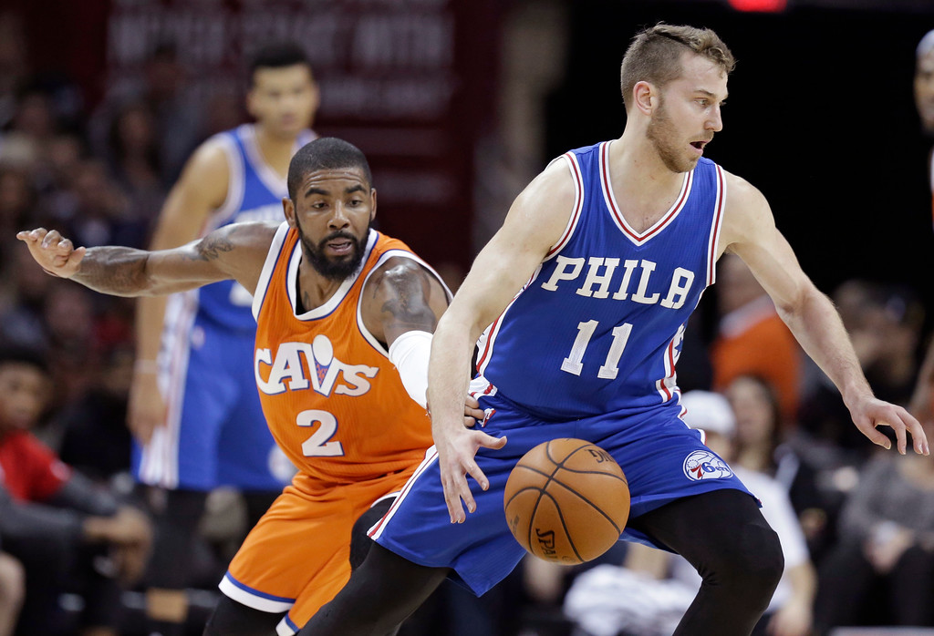 . Philadelphia 76ers\' Nik Stauskas (11) drives past Cleveland Cavaliers\' Kyrie Irving (2) in the first half of an NBA basketball game, Friday, March 31, 2017, in Cleveland. (AP Photo/Tony Dejak)