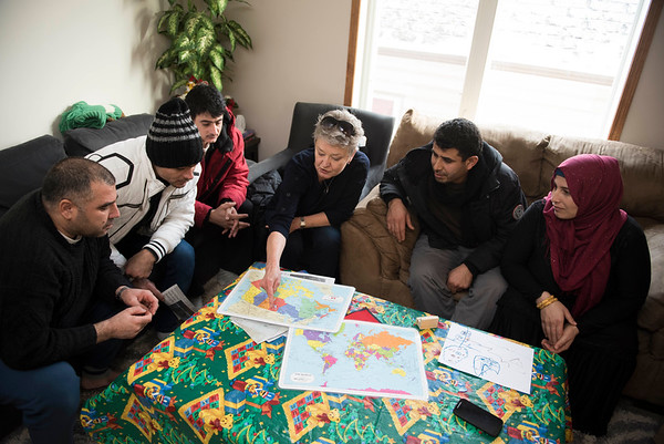 DAVID LIPNOWSKI / WINNIPEG FREE PRESS   left: Fadel Ahmad, Ibrahim Alsaho, Anwar Alsaho, volunteer instructor Val Schellenberg, Kamal Alhassan and his wife Amouna Alhassan gather at the home of Fadel and Rania Ahmad for conversational English classes twice a week Tuesday January 17, 2017.