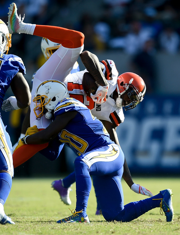 . Cleveland Browns wide receiver Josh Gordon, top, is tackled by Los Angeles Chargers defensive back Desmond King during the first half of an NFL football game Sunday, Dec. 3, 2017, in Carson, Calif. (AP Photo/Kelvin Kuo)