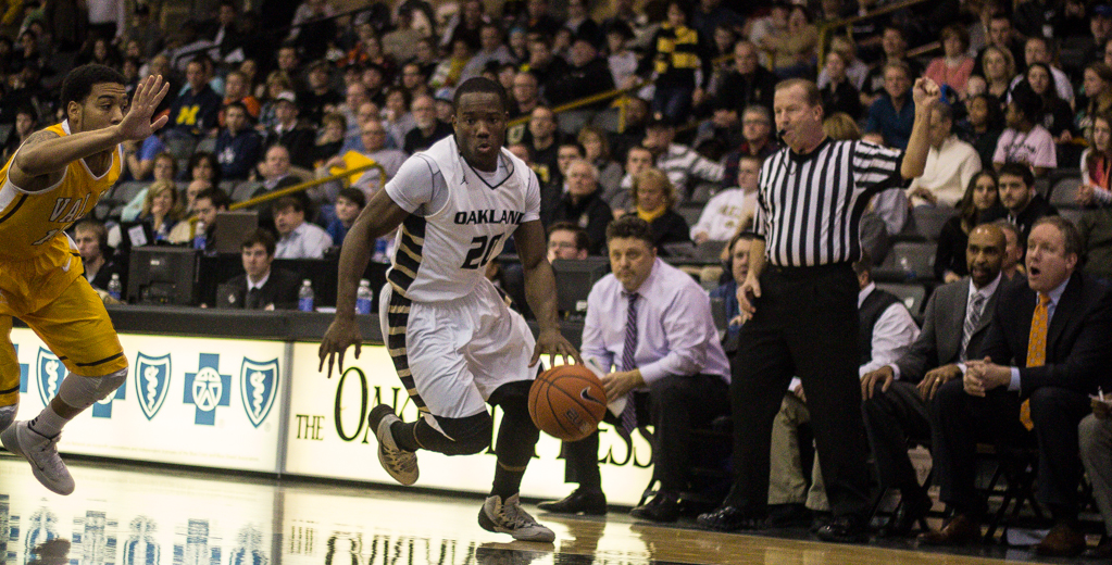 Description of . Felder works his way towards the hoop. Photo by Dylan Dulberg/The Oakland Press