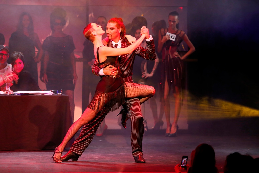 . Models performs a tango dance while presenting creations as part of Jean-Paul Gaultier\'s ready-to-wear Spring/Summer 2014 fashion collection, presented Saturday, Sept. 28, 2013 in Paris. (AP Photo/Jacques Brinon)