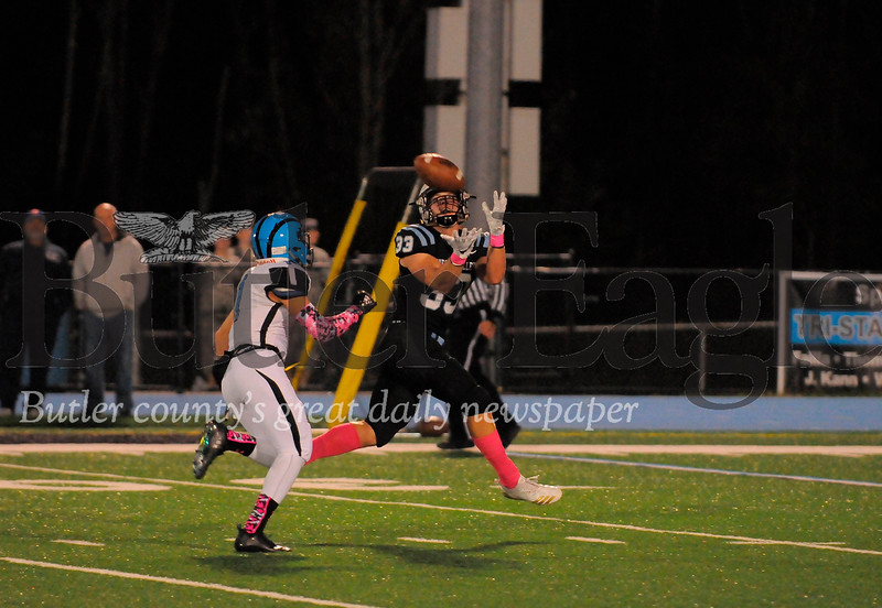 Seneca Valley #33 Jake Stebbins catches a long pass as Woodland Hills #1 Michael Roman gives chase during a game at Next Tier Stdium on Friday October 12, 2018 (Jason Swanson photo)