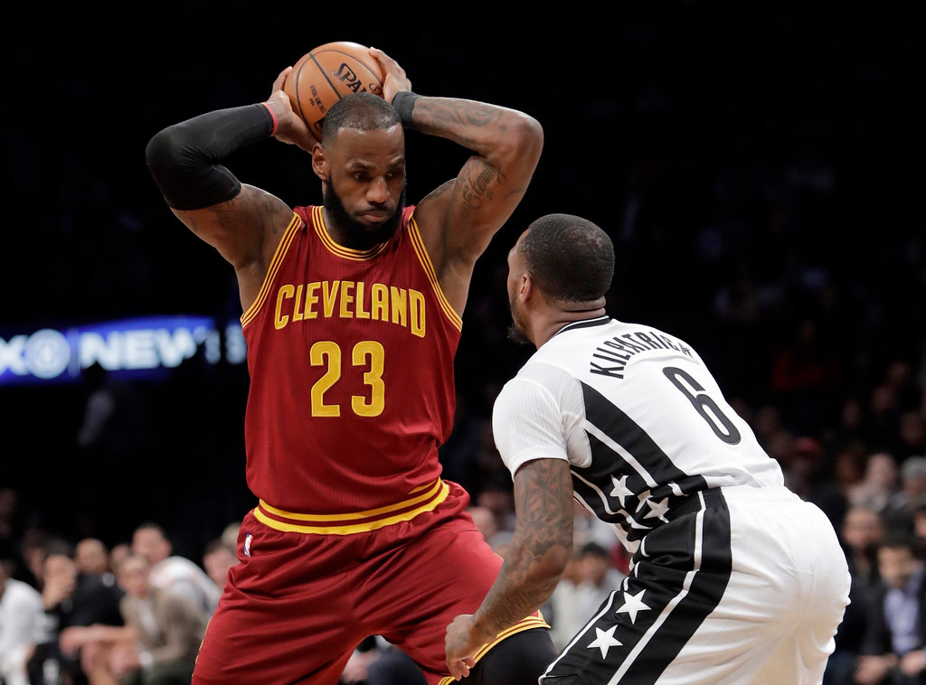 . Brooklyn Nets\' Spencer Dinwiddie (8) defends against Cleveland Cavaliers\' LeBron James (23) during the first half of an NBA basketball game Friday, Jan. 6, 2017, in New York. (AP Photo/Frank Franklin II)