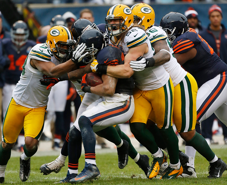 . Chicago Bears running back Matt Forte (22) sandwiched by Green Bay Packers linebackers Brad Jones (59) and Clay Matthews (52) and defensive tackle Mike Neal (96) in the first half of an NFL football game in Chicago, Sunday, Dec. 16, 2012. (AP Photo/Charles Rex Arbogast)