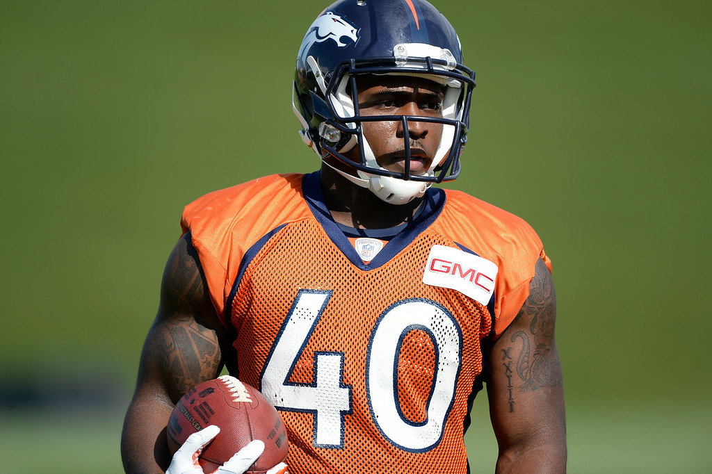 . Denver Broncos running back Juwan Thompson (40) runs through drills during the first day of the Denver Broncos 2014 training camp July 24, 2014 at Dove Valley. (Photo by John Leyba/The Denver Post)
