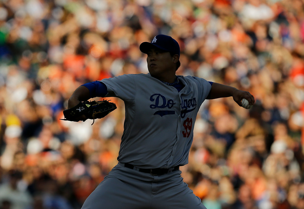 . Los Angeles Dodgers pitcher Hyun-Jin Ryu throws against the Detroit Tigers in the first inning of a baseball game in Detroit, Tuesday, July 8, 2014. (AP Photo/Paul Sancya)
