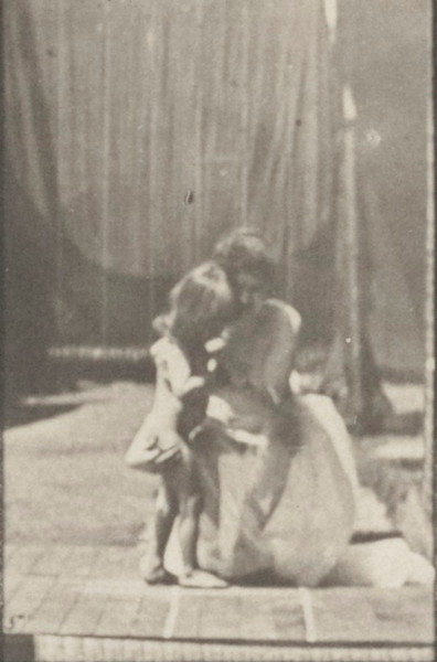 Semi-nude woman placing a child on the ground and the child running off