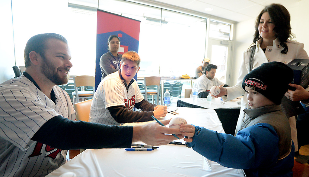 . Nine year-old Ethan Peltier, along with his aunt Natalie Rahn, has a baseball signed by former and now current Twin Jason Kubel at Twinsfest at Target Field, Saturday, January 25, 2014(Pioneer Press: John Autey)