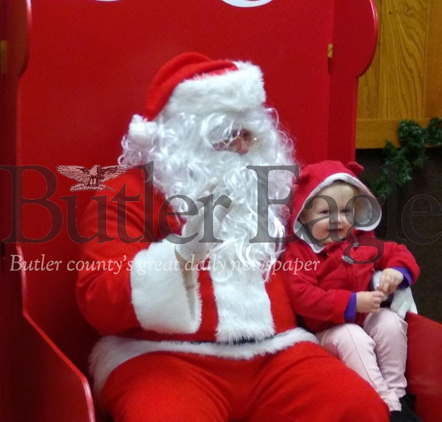 Kenna Mae Wickline, 2, sits with Santa at Breakfast with Santa on Saturday, Dec. 7, 2019, at the Butler Township Parks Building. The event was sponsored by the Butler County Parks and Recreation Department. Donna Sybert/ Butler Eagle