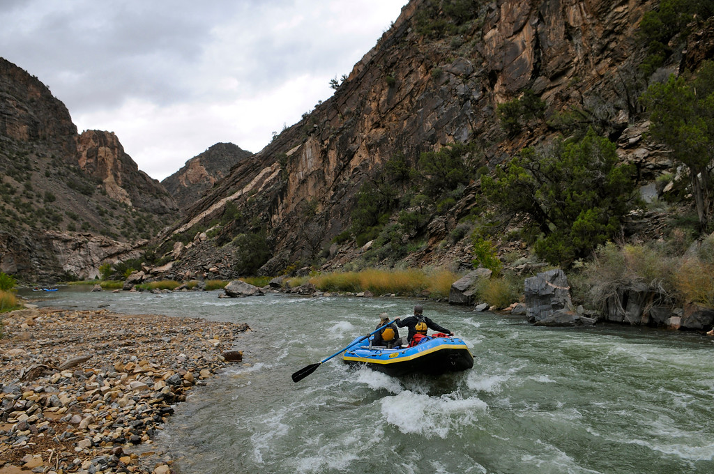 . A team of BLM employees and volunteers run their boats through the Chukar Rapids created when flash floods dumped dirt and debris into the Gunnison River below the Chukar Trail in July. The group spent the weekend posting signs, cleaning camps and tearing down the BLM ranger station before winter sets in upon the Gunnison Gorge. Scott Willoughby, The Denver Post