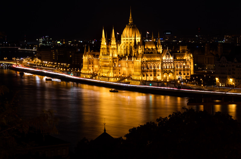 The Hungarian Parliament Building, also known as the Parliament of Budapest for being located in that city, is the seat of the National Assembly of Hungary, a notable landmark of Hungary.  It lies in Lajos Kossuth Square, on the bank of the Danube. It is currently the largest building in Hungary and still the tallest building in Budapest.
