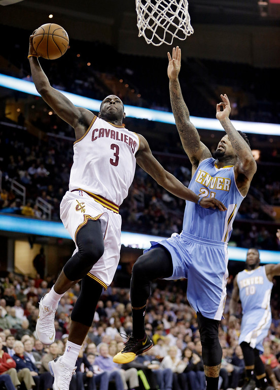 . Cleveland Cavaliers\' Dion Waiters (3) jumps toward the basket against Denver Nuggets\' Wilson Chandler (21) during the fourth quarter of an NBA basketball game on Wednesday, Dec. 4, 2013, in Cleveland. The Cavaliers won 98-88. (AP Photo/Tony Dejak)