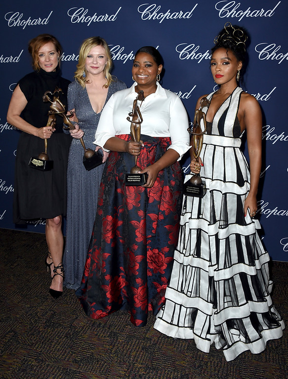 ". Members of the cast of ""Hidden Figures\"" Kimberly Quinn, from left, Kirsten Dunst, Octavia Spencer and Janelle Monae pose backstage with the ensemble performance award at the 28th annual Palm Springs International Film Festival Awards Gala on Monday, Jan. 2, 2017, in Palm Springs, Calif. (Photo by Jordan Strauss/Invision/AP)"