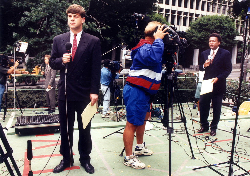 ". Three television reporters make simultaneous reports Monday from ""Camp O.J.,\"" the media gathering-place in the Hall of Justice parking lot.  (9/26/94)   (Los Angeles Daily News file photo)"