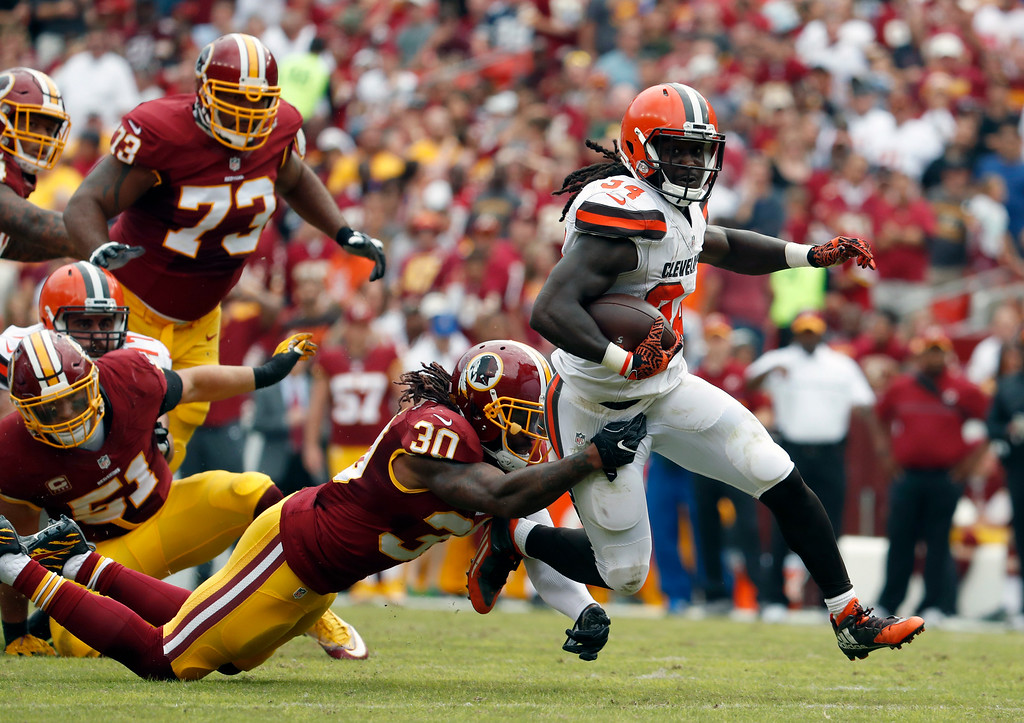 . Washington Redskins strong safety David Bruton (30) tackles Cleveland Browns running back Isaiah Crowell (34) during the first half of an NFL football game Sunday, Oct. 2, 2016, in Landover, Md. (AP Photo/Carolyn Kaster)