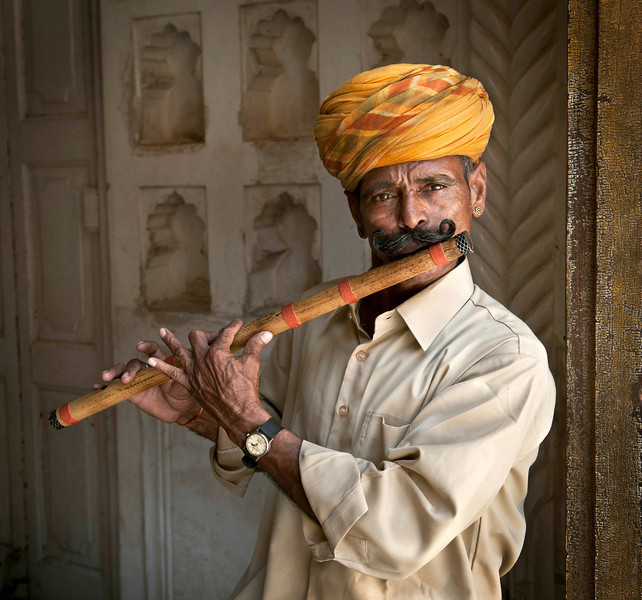 Man playing the flute at the Mehrangarh Fort in Johdpur.  Rajasthan, India, 2011.