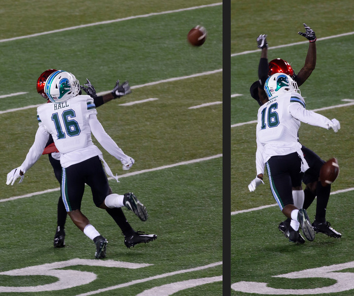 Tulane's Hall breaks up a pass to Stevenson.
