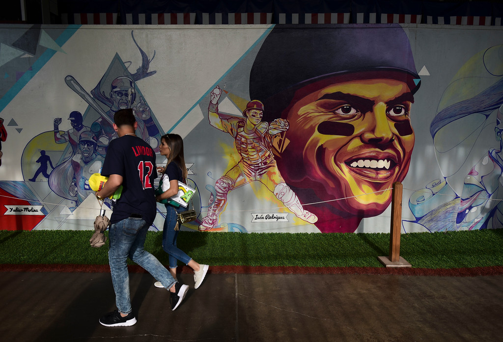 . A mural of Puerto Rica\'s former Major League Baseball catcher Ivan Rodriguez stands inside Hiram Bithorn Stadium, where the final match of a two-game Mayor League Series between the Minnesota Twins and the Cleveland Indians will take place in San Juan, Puerto Rico, Wednesday, April 18, 2018. (AP Photo/Carlos Giusti)