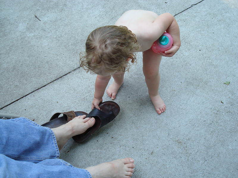 Beverly helps Deb put on her sandals